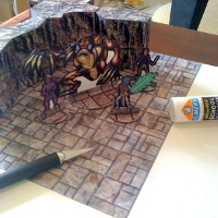 An image of an unfinished RPG terrain board with some miniatures, walls, and craft tools