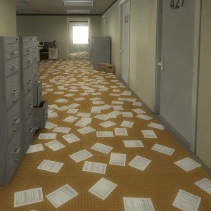 A screenshot from The Stanley Parable with papers scattered on the floor of an office